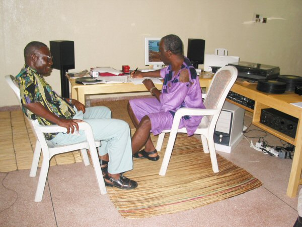 Peter Legrand at left being interviewed by Kwame Sarpong (2004)